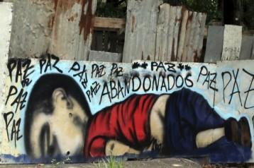 une_peinture_murale_du_petit_aylan_mort_a_cause_de_la_barbarie_des_frontieres-_dr